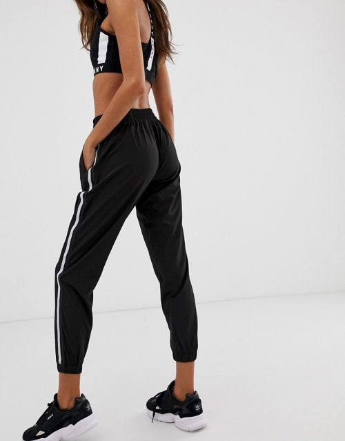 DKNY woven tracksuit pant with reflective tape detail