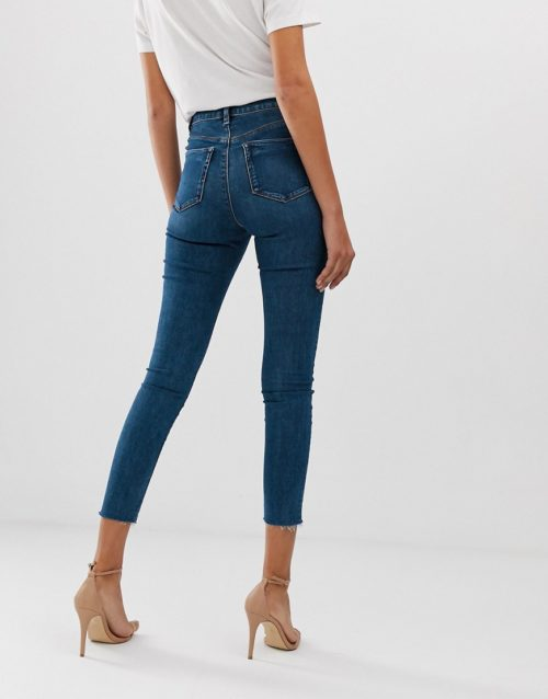 ASOS DESIGN Ridley high waisted skinny jeans in mid wash blue with front seam and vent hem detail