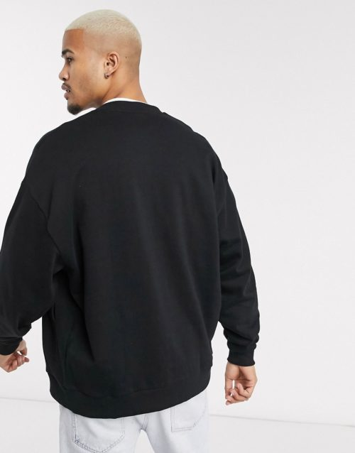 ASOS DESIGN organic oversized jersey bomber jacket with poppers in black