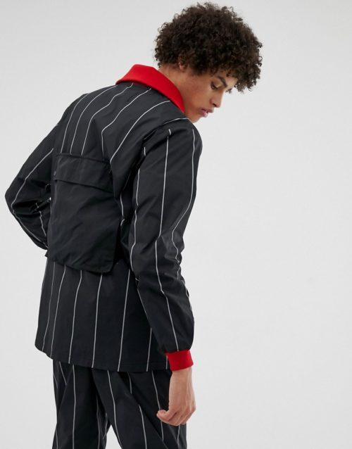 LYPH windbreaker jacket with detachable pockets in black stripe