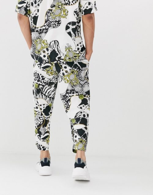Reclaimed Vintage baroque animal chain print trousers-White