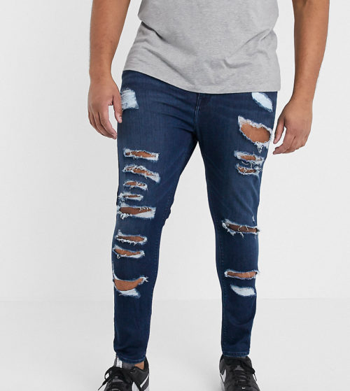 ASOS DESIGN Plus spray on jeans in power stretch denim in dark wash blue with heavy rips