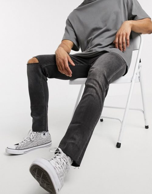 ASOS DESIGN cropped skinny jeans in washed black with knee rips