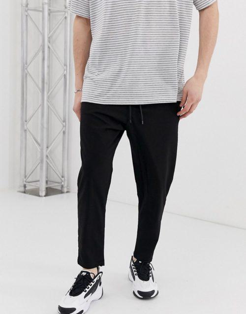 Bershka carrot fit trousers in black